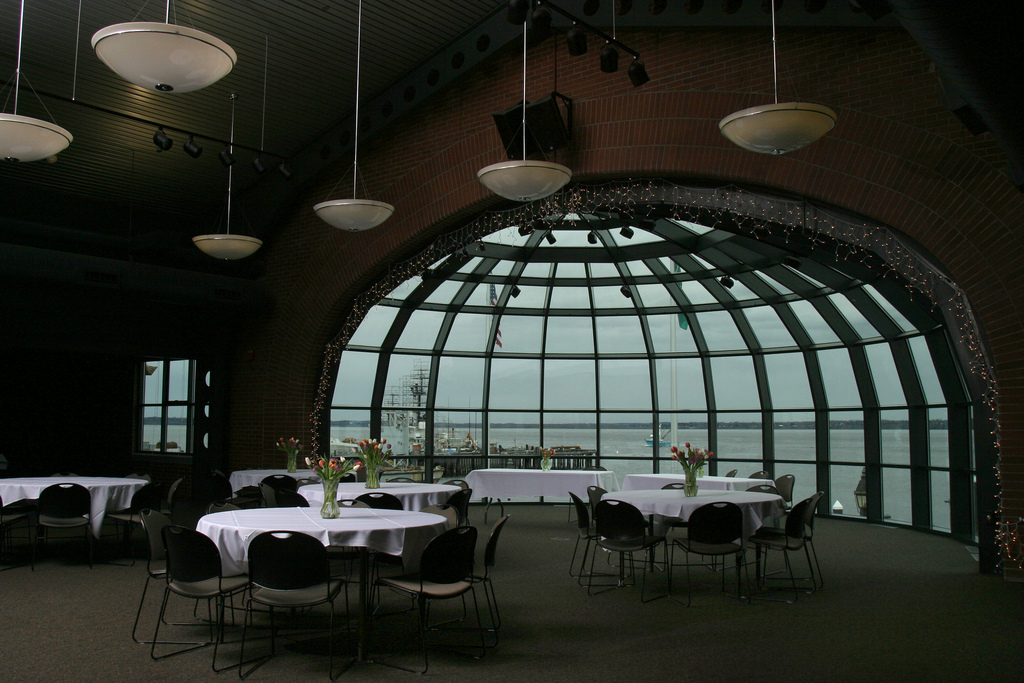 Round tables and chairs set up in the Bellingham Cruise Terminal dome room
