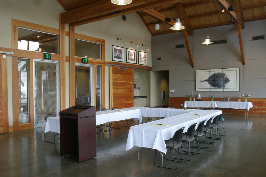 Table and podium set up in Squalicum Boathouse