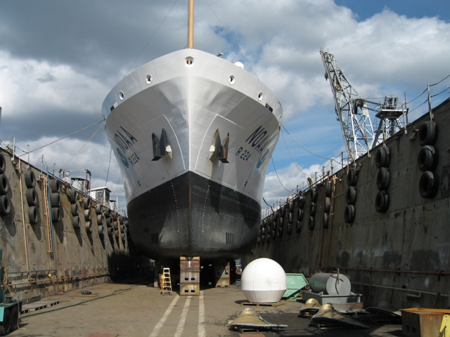 A NOAA ship is repaired in the Fairhaven dry-dock.